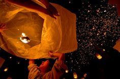 Buddhists in Thailand, Myanmar and Laos celebrate the Buddhist New Year. In Northern Thailand, they launch lanterns as a way to release their sins for the entire year.