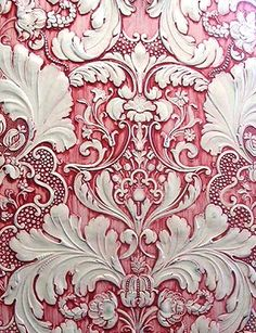 To achieve this effect on anaglypta wallpaper, use water based paints and apply red paint to a white acrylic primer based coat. Drag and wipe to create cream highlight coat.