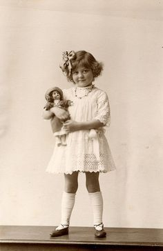 With a doll in 1918 by lovedaylemon, via Flickr