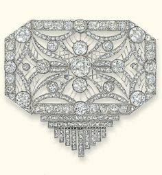 AN ART DECO DIAMOND BROOCH  Of geometric design, the octagonal-shaped openwork panel highlighted with circular-cut diamond collets to the old-cut diamond border and rose-cut diamond and trellis centre suspending a stylised tassel, circa 1920.