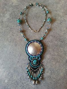 Mexican dollar w/ turquoise- $200