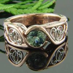 Rose gold and green sapphire Celtic ring
