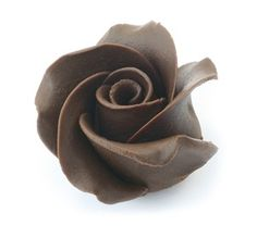 Chocolate Trading Co Dark chocolate roses - Box of 15 Dark Chocolate Chocolate roses for decorating wedding and celebration cakes. These dark chocolate roses are handmade to a superior finish to decorate the most exquisite of cakes. Save yourself considerable time crea http://www.comparestoreprices.co.uk/food-delivery/chocolate-trading-co-dark-chocolate-roses--box-of-15-dark-chocolate.asp