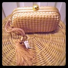 Gold Woven Neiman Marcus Tassel Clutch Neiman Marcus evening bag. This is a wonderful iconic Bottega style bag that you will be able to carry to a variety of events. It is a lovely gold shade. It is 7 x 4 and can be carried as a hand or wrist bag, clutch or shoulder/crossbody strap. Neiman Marcus Bags Clutches & Wristlets