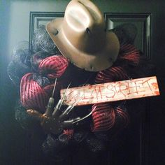 Freddie wreath! Made with a custom Elm Street sign, red and black deco mesh, Freddie claws and a Freddie hat!  www.facebook.com/hopeshangings  Place your Halloween orders now!
