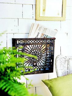 L-O-V-E!! UPCYCLED metal heating grate makes a LOVELY newspaper or mail rack!