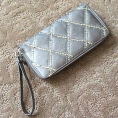 Rhinestone wristlet Wristlet/wallet in faux pewter leather with rhinestone detail in quilted pattern. Two sections with 8 card slots and one zip section. Used a couple times, great condition. From a boutique in Boston. Bags Clutches & Wristlets
