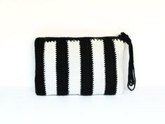 Black and white striped crochet clutch (wristlet) with strap by SILAYAYA on Etsy https://www.etsy.com/listing/157258731/black-and-white-striped-crochet-clutch