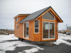 This portable cabin combines great features with a compact design for tight installations. Since the bedroom is in the loft, the living room is quite large and will fit a lot of your furnishings. The kitchen has apartment size appliances and is fully functional for your