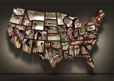 Bookcase shaped like the map of the United States, cool creation by Ron Arad.  Love the idea, would like a Canadian version.