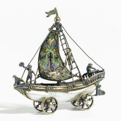 A miniature silver-gilt, enamel and mother of pearl Nef | sotheby's