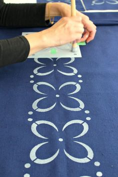 If you've ever searched for a certain fabric print or table linen to no avail, here's a tutorial for you: learn how to make your own DIY stenciled fabric with this stencil fabric tutorial. Make your own DIY stenciled fabric with paint. This stencil fabric DIY is SO easy and fun! #stencilideas #stencilfabric