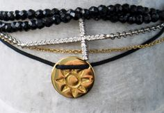 Layering is right on trend love this combo - Sun Friendship Bracelet with Intertwining Black Stone Bracelet and Cubic Cross www.issyray.com