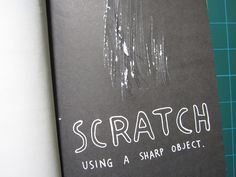 """Scratch using a sharp object."""