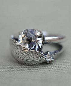 YESSS!!!!!!! Engagement ring with feather wedding band