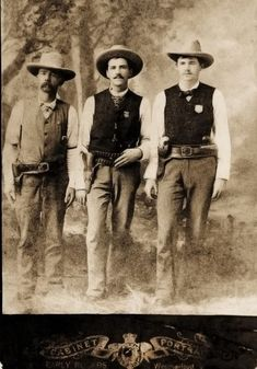 Shortly after this photo was taken, Texas Deputy U.S. Marshal Edward W.  Johnson (at left) lost his right arm in an 1888 gunfight.