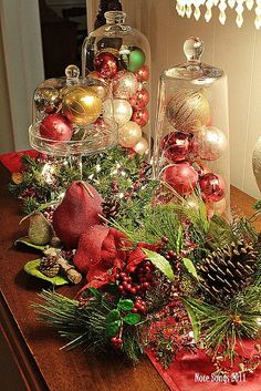 Christmas table setting - I like the idea of covering ornaments with a cake dome.