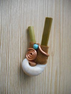 Kuripe with sea snail, leather, turquoises and copper spirals. www.faceboook.com/MotherofWater