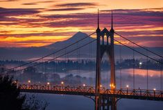 Portland, OR sunrise, looking out at Mt. Hood and the St. John's Bridge | Instagram photo by @steveschwindt