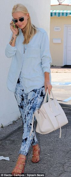 Stepping out: The 24-year-old performer teamed tie-dye skinny jeans with a pale blue shirt...