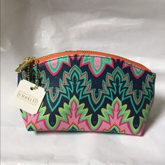 Cinda B makeup bag! NWT Cinda B makeup bag! New with tags! Bright fun colors! Zipper closure, high quality. Oxford Calypso print. 7.5 x 4 inches! Great for you or to give as a gift! Cind B Bags Cosmetic Bags & Cases