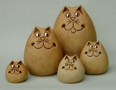 Pottery cat figurines by Graham Glynn