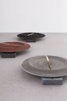 Monti Silvestri Clock by Studio Formafantasma tells time with brass fittings circling a crater of powdered volcanic rock, set on a base of lava-formed basalt, witness to the impact of eruption on the place where it occurred. Lava, Vases, Brass Fittings, Messing, Black Glass, Furniture Collection, Interiores Design, Home Accessories, Decoration