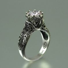 This ring is fantastic! The ENCHANTED PRINCESS Moissanite 14K gold by WingedLion on Etsy, $2435.00