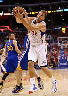 Description of . Blake Griffin #32 of the Los Angeles Clippers fights for the ball with David Lee #10 of the Golden State Warriors in Game Seven of the Western Conference Quarterfinals during the 2014 NBA Playoffs at Staples Center on May 3, 2014 in Los Angeles, California. (Photo by Stephen Dunn/Getty Images)