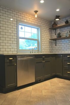 metro tiles, grey grout, dark cabinets, wood shelves with black brackets