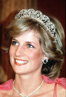 Princess Diana, Princess of Wales, smiles while wearing the Spencer Family Tiara at a State Reception in Brisbane, Australia in April, 1983.