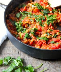 Go-To Spinach & Chickpea Curry - olive oil, onion, garlic cloves, minced ginger, garam masala, cumin, cayenne pepper, chickpeas, tinned chopped tomatoes, sugar (optional, would omit), fresh baby spinach, fresh coriander (optional), fresh lemon (optional), salt & pepper