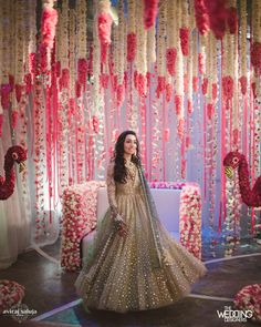 Indian Wedding Decor - Red and White Hanging Decor with a Twirling Bride in a Gold and Mint Sequinned Outfit | WedMeGood #wedmegood #indianwedding #indianbride #weddingdecor #decor #hangingdecor #indianweddingdecor