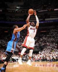 Dwyane Wade of the Miami Heat shoots against Russell Westbrook of the Oklahoma City Thunder during Game Four of the 2012 NBA Finals, http://www.fansedge.com/Dwyane-Wade-Miami-Heat-NBA-Finals-Game-4-6192012-_745357961_PD.html?social=pinterest_pfid77-20387