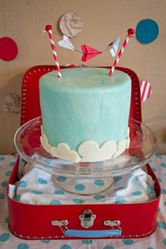 Adoption shower cake - airplane theme - lemon truffle cake with white chocolate ganache, blue swirl marshmallow fondant, white fondant clouds and a mini paper airplane garland