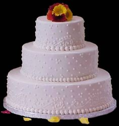 pink three tier round butterfly cake | beautiful three tier wedding cake with the brides throw away bouquet ...