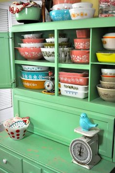 Pyrex collection in vintage green cabinet.