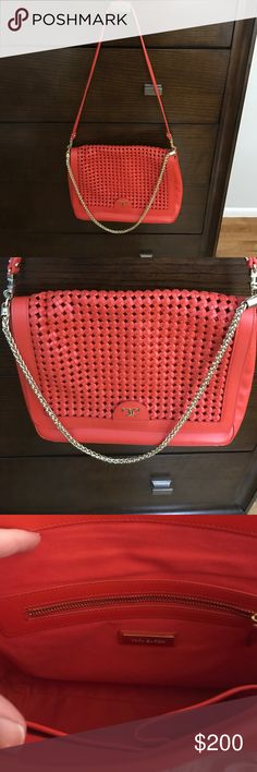 Tory Burch Leather Shoulder bag. Used seldom. In perfect condition Tory Burch orange leather shoulder bag. Leather and gold shoulder strap which can be worn together or separate. Inside with zip pocket and 2 open pockets. Comes with original cover bag. Tory Burch Bags Shoulder Bags