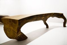 Natural wood bench by Kaspar Hamacher found on mmmarchitecture.