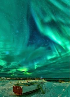 Rowboat on the beach under the #Northern lights in Norway - #Turquoise and #Green glowing skies. SKY LIGHTS. Photo pinned via Heather L