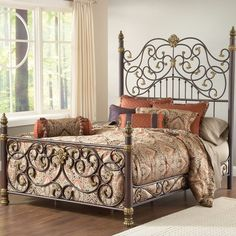Bed with a scrolling silhouette and bronzed highlights.  Product: King bedConstruction Material: Heavy gauge tubular ...