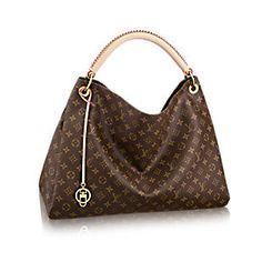 8783688d08ed Discover Louis Vuitton Artsy MM  The Artsy MM embodies understated bohemian  style. Louis Vuitton  iconic and divinely supple Monogram canvas is  enhanced by ...