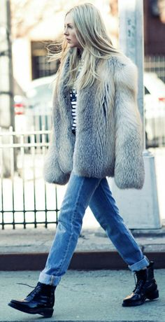 Shea Marie + fluffy faux fur coat + rolled jeans + edgy combat style boots   Brands not specified.