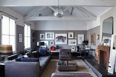 View all our living room ideas, like this great grey scheme with lots of pictures on the walls