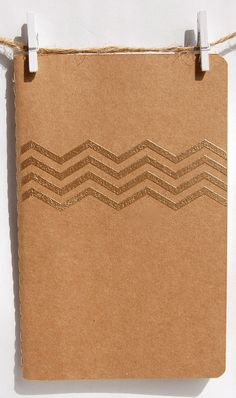 Gold Chevron Journal, Stamp Embossed Soft Cover Craft Paper Notebook, Jotter. $7.50, via Etsy.