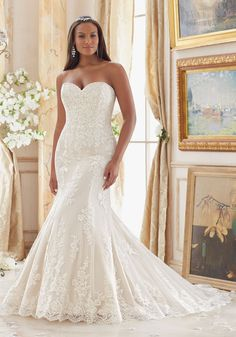 Embroidered Lace Appliques on Tulle with Scalloped Hemline Plus Size Wedding Dress Designed by Madeline Gardner.