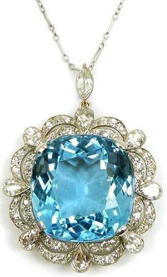 Early 20th century single stone aquamarine and diamond cluster pendant/brooch, c.1920, the cushion shaped aquamarine claw set to a scalloped... by CherBearV