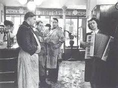 Muchacha tocando el acordeón Robert Doisneau, 1957