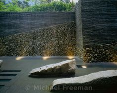 The water garden in a modern Zen garden at the Kojimachi Kaikan in central Tokyo, Japan. The stones represent Buddhist cosmology. The designer, Shunmyo Masuno, is a Zen priest and the acknowledged master of modern Zen gardens