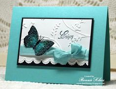 By Bonnie Klass. Pretty card! Emboss the background. Edge made with Adorning Accent Edgelit. Stamp the sentiment. Add ribbon. Mount on darker blue & then on card base. Add butterfly.